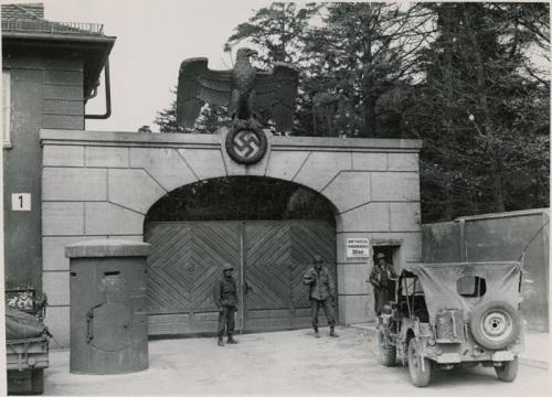 US Army jeep at the gates of Dachau, 1945