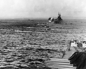 LVTs (Landing Vehicle Tracked) heading for the shore of Saipan Island on 15 June 1944