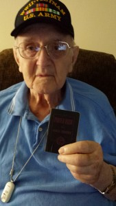Bob Serafin with World War II prayer book.